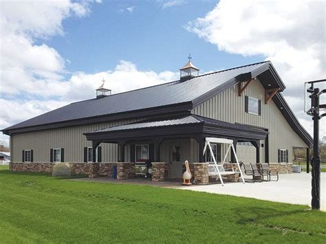 building a barn house rock wainscoting on metal building with gable arch