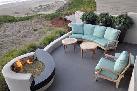 Beach fire pit ideas landscape beach style with seat wall potted plants waterfront