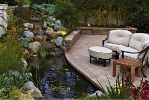 Backyard pond and patio with a rock waterfall mediterranean patio