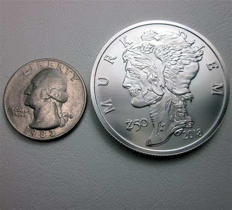 half dollar size compared to a quarter pictures to pin on pinterest pinsdaddy