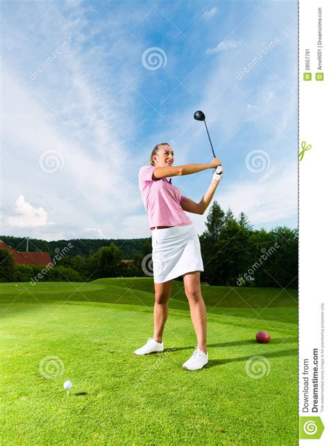 female golf swing young female golf player on course doing golf swing stock