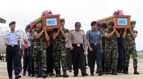 airasia victims airasia flight 8501 bad weather hobbles indonesia jet