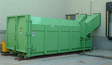 how does a commercial trash compactor work self contained compactors reference guide