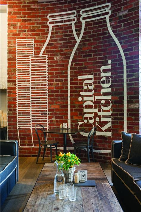 interior brick wall designs logo on brick wall of clean and modern cafe with home
