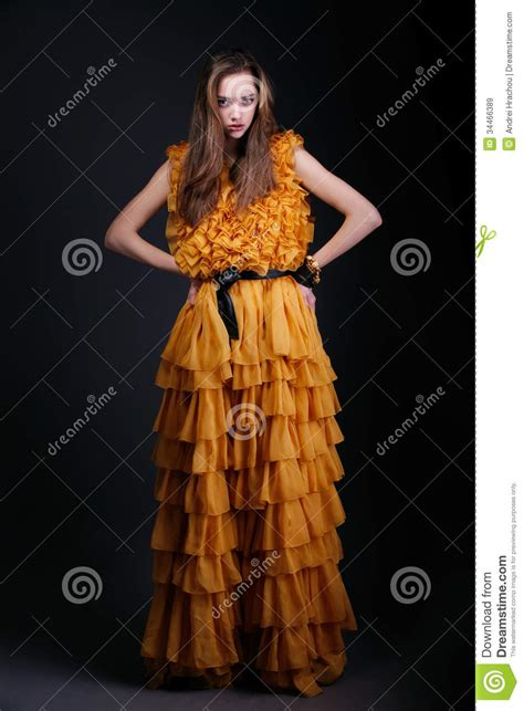 pretty in yellow dress looking at royalty