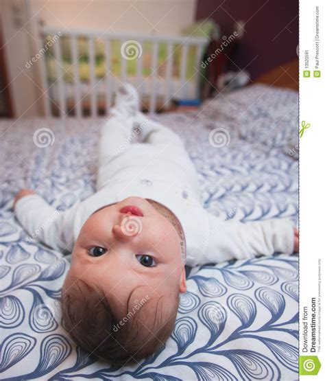 lay on the bed baby laying on bed stock image image 13520591