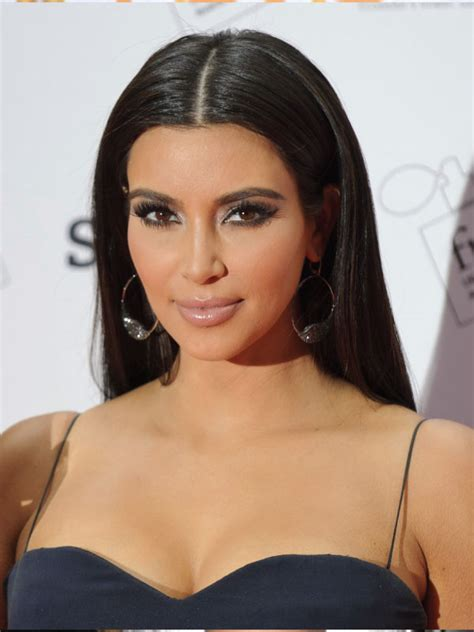 off centre middle part kim kardashian with a sleek middle part hairstyles