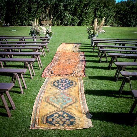 persian rugs as the aisle for outdoor wedding ceremony