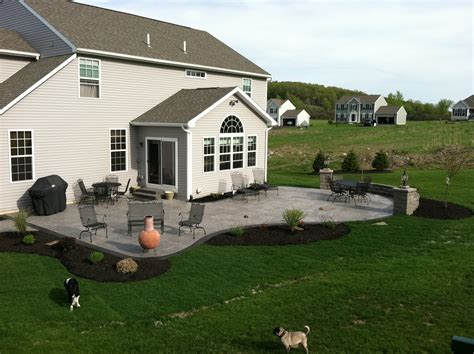 Backyard Border Landscaping Ideas - stamped concrete patio with steps nucrete