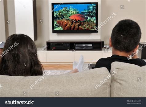 watching tv on couch two kids on couch watching tv stock photo 63462697