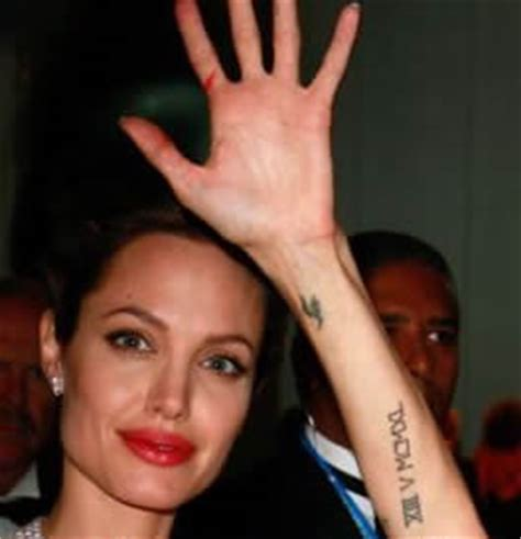 tattoo on angelina jolie s hand angelina jolie tattoos images in left hand tattoomagz