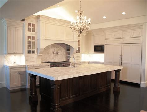 white kitchen island with top white wooden kitchen cabinet with white marble counter top