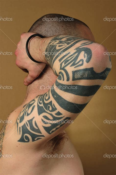 tattoo tribal op been tribal tattoo op arm stockfoto 169 oigro 9354587