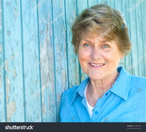 prity 70 year old weman lovely seventy year old woman smiling in blue shirt with