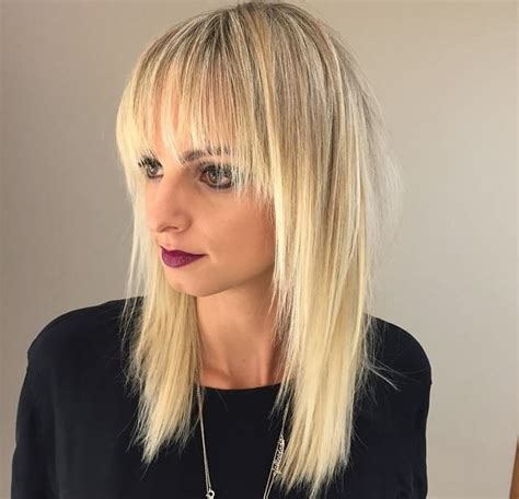 blonde hairstyles with bangs and layers women s long blonde shaggy layered cut with fringe bangs