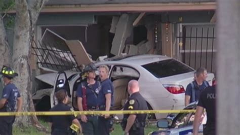 car hits house car hits house after dragging orlando police officer