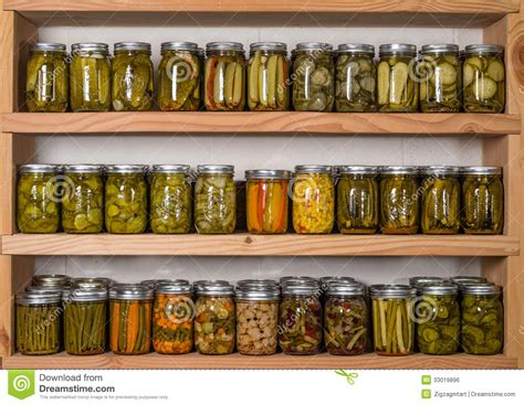 storage shelves with canned food royalty free stock image