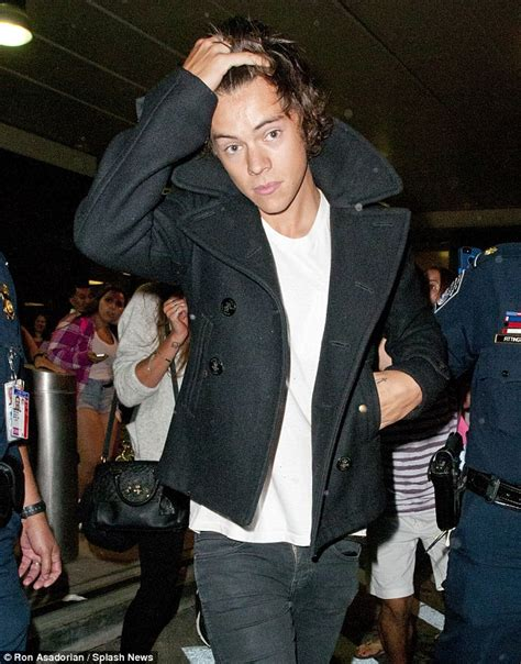 harry styles running his fingers through his hair harry styles running his fingers through his hair