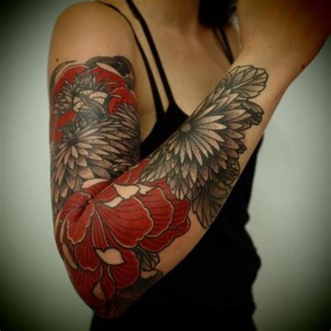 black and grey tattoo with red 100 women s arm tattoo designs that won t have you up in arms