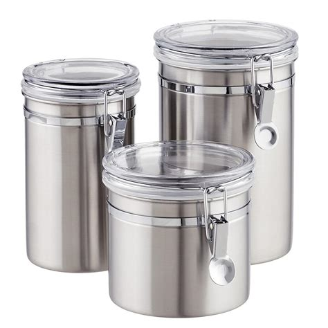 kitchen storage canister set of brushed stainless steel canisters the container store
