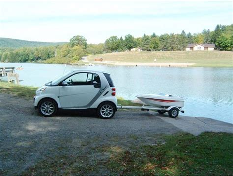 towing smart car strange vehicles smart car towing tiny boat on trailer