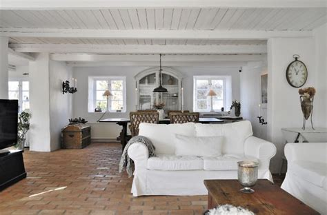 swedish farmhouse style farmhouse surrounded by beautiful landscape and wonderful
