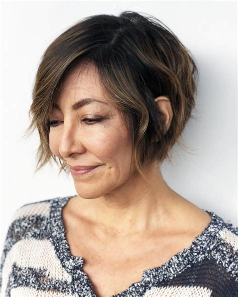 women s undone textured lob with long side swept bangs and pale stunning side swept short hairstyles pictures styles