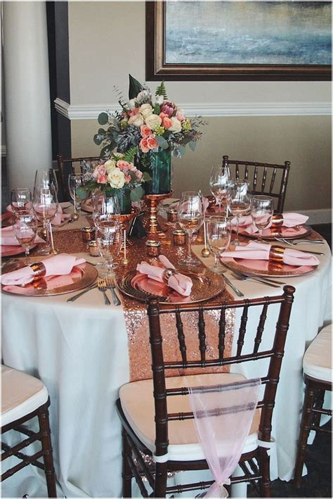 Beautiful tablescape with rose gold sequin runners, copper