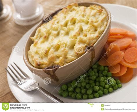 Individual Cottage Pie by Individual Cottage Pie With Peas And Carrots Royalty Free