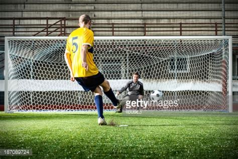 Kaos Pahlawan Shoot Goal Premium football match in stadium penalty kick stock photo getty images