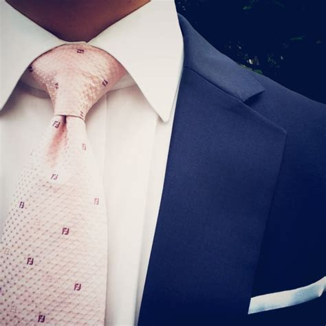 blush pink tie paired with blue suit and white pocket