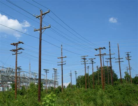 electric light pole penn power replaces repairs transmission poles