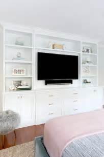 built in bedroom storage bed facing built in tv unit transitional bedroom