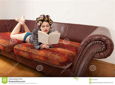 lying on the couch book portrait of a model with a book stock photo image 50132319