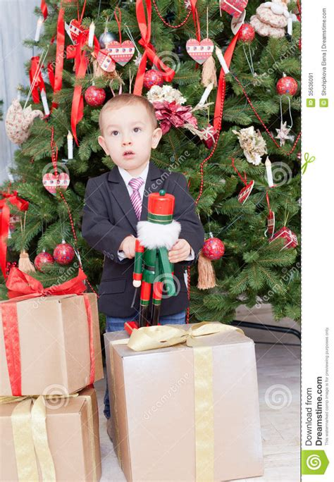 little boy plays with the wooden nutcracker stock image