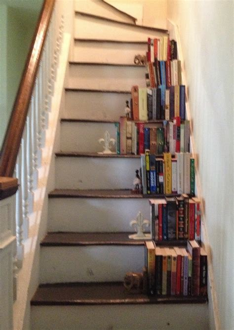 white painted wooden bookcase stairs with ladder