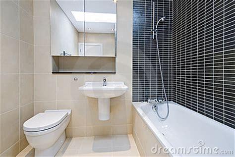 beige bathroom suite modern en suite bathroom in beige with black tiles stock