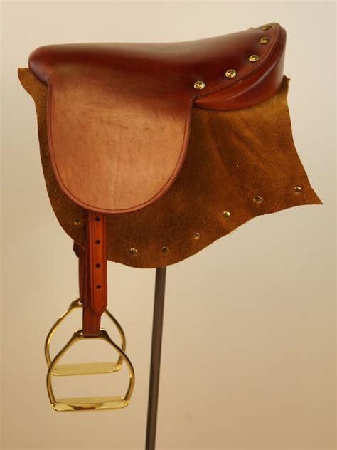 medium separate saddle tan store woodcarver