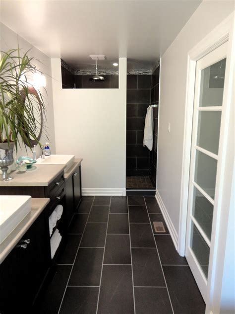 dark tile bathroom floor my master bathroom modern budget friendly