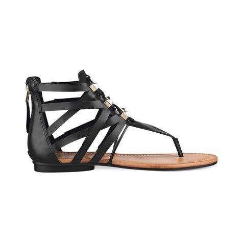 black flat gladiator sandals lyst guess glando gladiator flat sandals in black