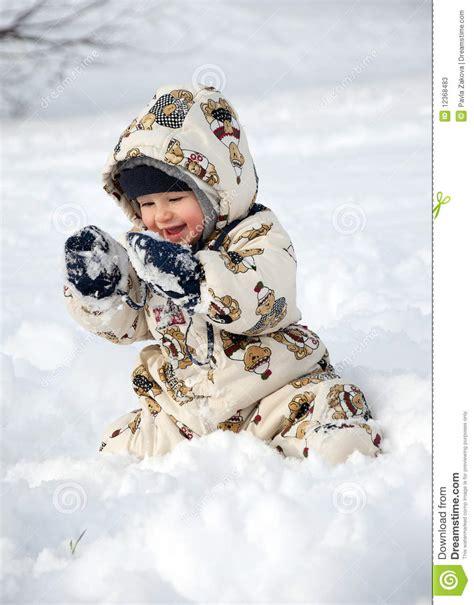 Snow Happy happy baby in snow stock photos image 12368483