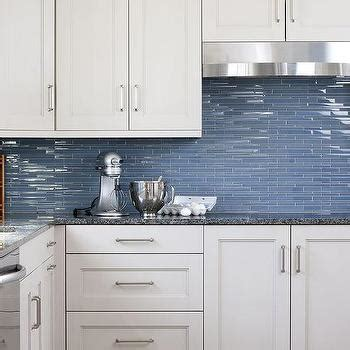 white kitchen cabinets blue glass backsplash design ideas