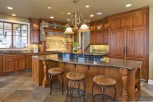 superb Kitchen Island Centerpiece Ideas #1: kitchen-cabinets-traditional-medium-wood-golden-brown-062-s30956167-wood-hood-island-luxury.jpg