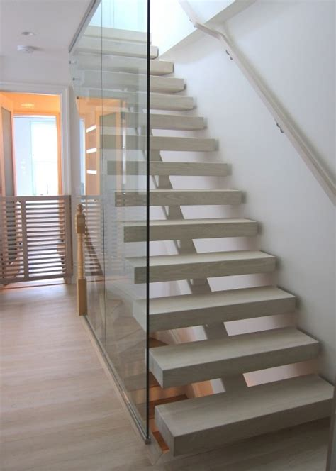 open riser staircase  glass wall stairs interior