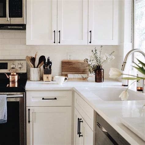 White Kitchen Cabinet Hardware Ideas White Cabinets With Black Hardware The Everygirl Decorates Pinterest White Cabinets