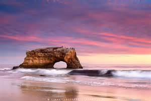 sunset at natural bridges state beach along the california