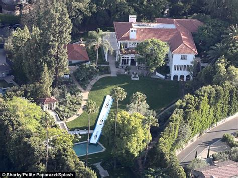 angelina jolie mansion angelina jolie adds slide to pool at 25m home daily