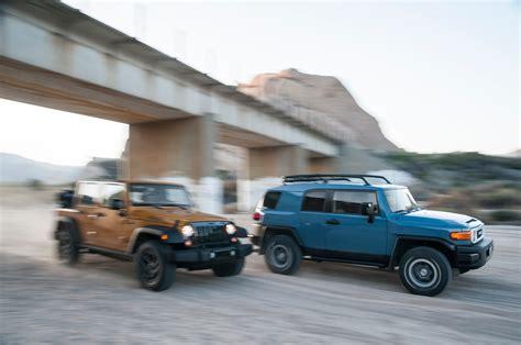 Fj Cruiser Vs Jeep Wrangler 2014 Jeep Wrangler Unlimited Vs 2014 Toyota Fj Cruiser