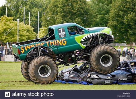 videos of monster trucks crushing cars monster truck crushing cars stock photo royalty free