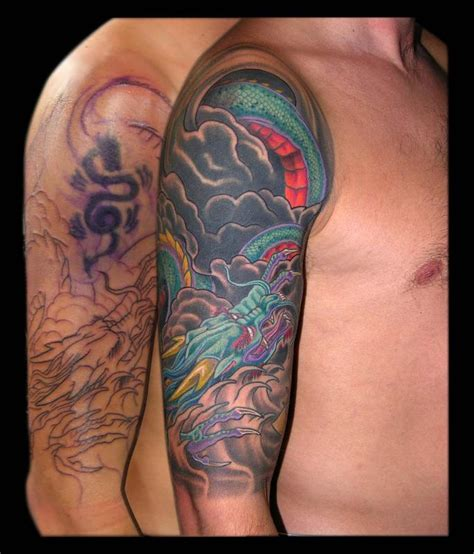 quarter sleeve tattoo cover up asian dragon and yellow lotus cover up half sleeve by